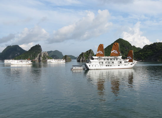 Experience the serene magic of world famous Halong Bay with 2 days 1 night onboard